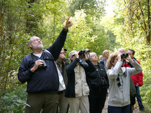 Tim Griffith helps people spot birds at the Eagle Slough Dedication Ceremony in October 2012. Photo by Patrick Petro.