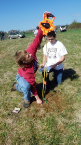 Students measure a newly-planted tree to begin tracking data. Photo by Carroll Ritter.