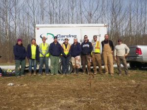 A Cardno JFNew team planted trees to restore a floodplain at Beanblossom Bottoms in memory of their former colleague, Bruce Behan. Photo by John Lawrence.