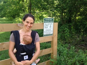 Lindsay Wood with baby Georgia near the new Wood Preserve she and her husband, Loren, helped Sycamore protect.