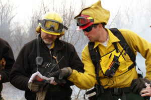 Trained fire crew members consult the map of Columbia Mine Preserve during the prescribed burn in March 2015. Photo by Steve Gifford.