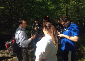 Environmental Education Director Shane Gibson teaches the Community Transitions students about seed dispersal at Beanblossom Bottoms. Photo by Jennifer Robinson.