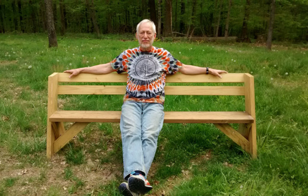 Volunteer Terry Usrey with the inaugural Naming Opportunities bench he designed and built for Sycamore. Inspired by one he saw in Tennessee, the design of this bench resembles the model originated by conservationist Aldo Leopold. Photo by Terrie Usrey.