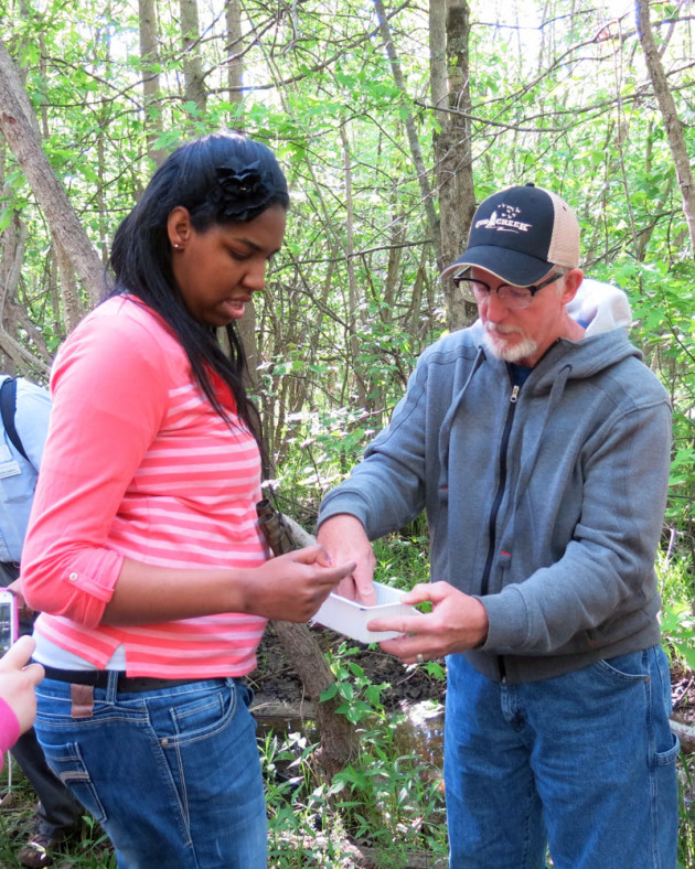 Alexa, an MCCSC Community Transitions student,  Alexa gets a thrill out of crawdads with Dave Reid at Beanblossom Bottoms. Photo by Jennifer Robinson.