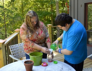 MaryEllen and Joshua work together to pour fresh nectar into the hummingbird feeders.