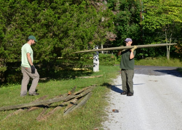 Mike Davis helps Assistant Director John Lawrence install new fence rails at Cedar Crest, Sycamore's headquarters. Photo by Jaime Sweany.