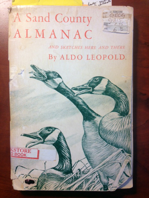 """Shane's original copy of """"A Sand County Almanac,"""" purchased at the IU Memorial Union for $6.71, gave voice to his love of nature and literature."""