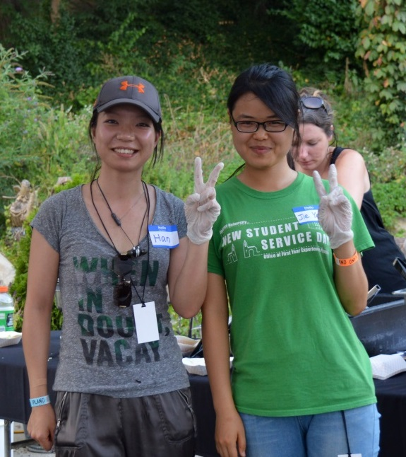 Jie Yan (right) was introduced to Sycamore by her friend Han, both of whom love nature and giving back. In September, they volunteered at Hillbilly Haiku Music Festival. Photo by Jaime Sweany.