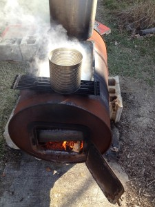 Gibson's homemade cooker was made with a 55-gallon drum. The barrel became the firebox. We purchased a wood stove kit to add the cast iron door and legs. A restaurant-style chaffing pan rests in a hole in the top of the drum.