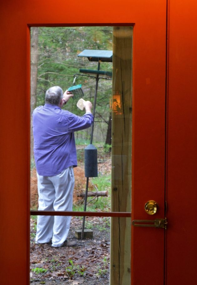 Scott Loman takes care of the birds. Photo by Jaime Sweany.
