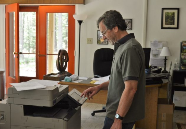 John working his magic at the copier! Photo by Jaime Sweany.